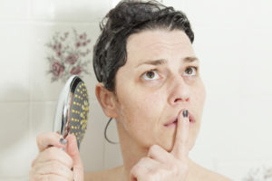 Woman thinking in shower